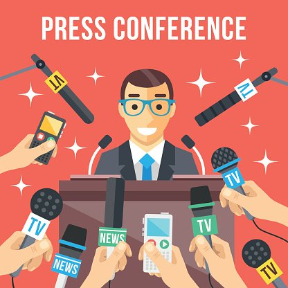 106234525-press-conference-speaker-standing-at-rostrum-many-microphones-mass-media